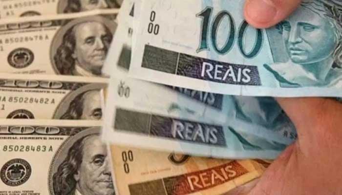 Dólar fecha no menor nível em dez semanas e cai para R$ 5,08